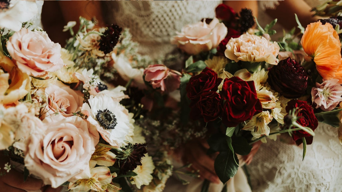 Two brides are better than 1 red and orange fall floral blooms pink and autumn colors