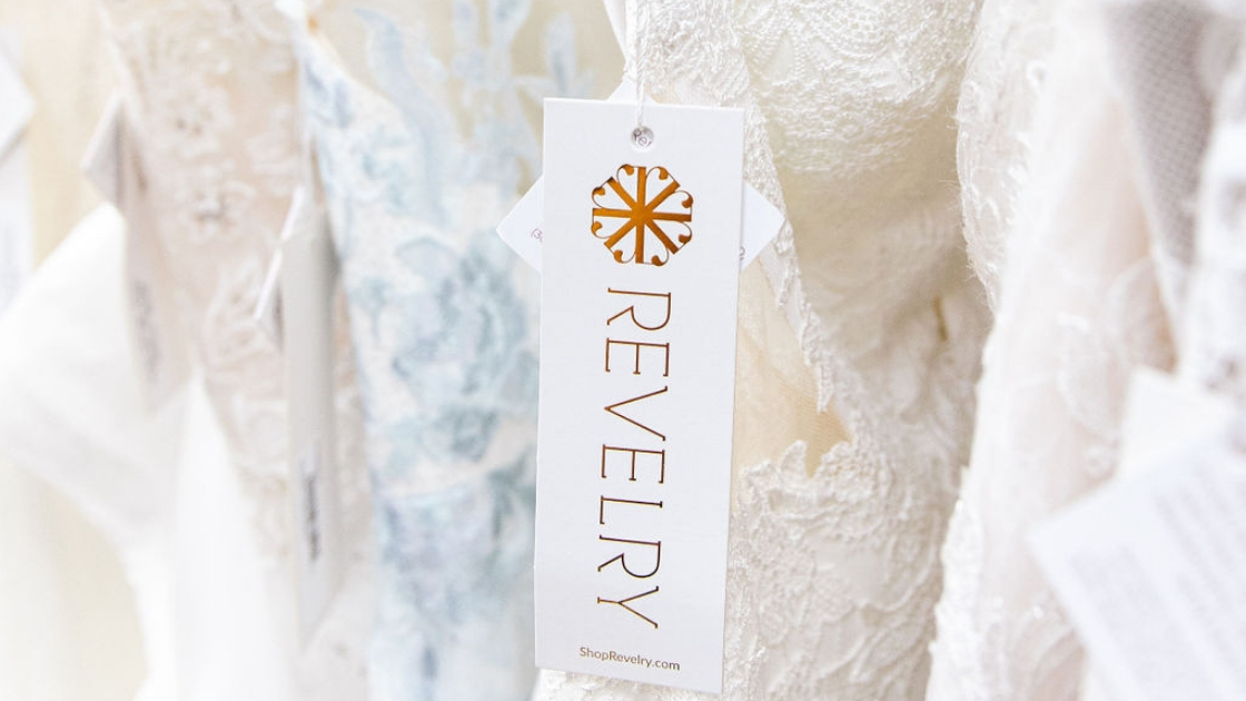 Two brides are better than 1 Revelry tag on bridal wedding dresses gold logo for austin texas company