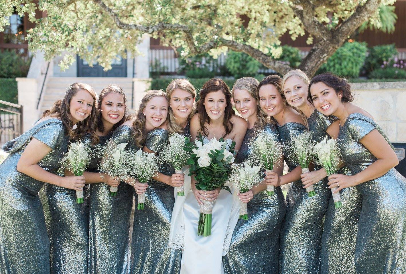 bridesmaids in spring wedding wearing charcoal sequins to support their bestie on the big day.