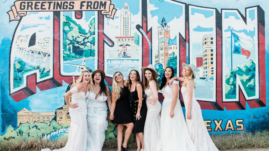 5 brides from around the country pose with revelry found and rachel varina in austin texas for weekend retreat