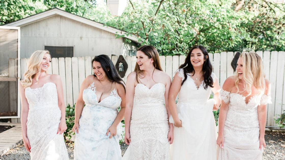 5 finally the brides in revelry wedding dresses in austin texas for retreat walking in a line smiling and laughing