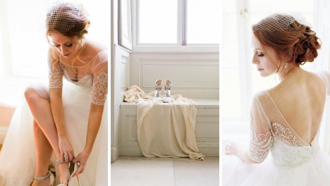 Bride getting ready in wedding dress before ceremony.