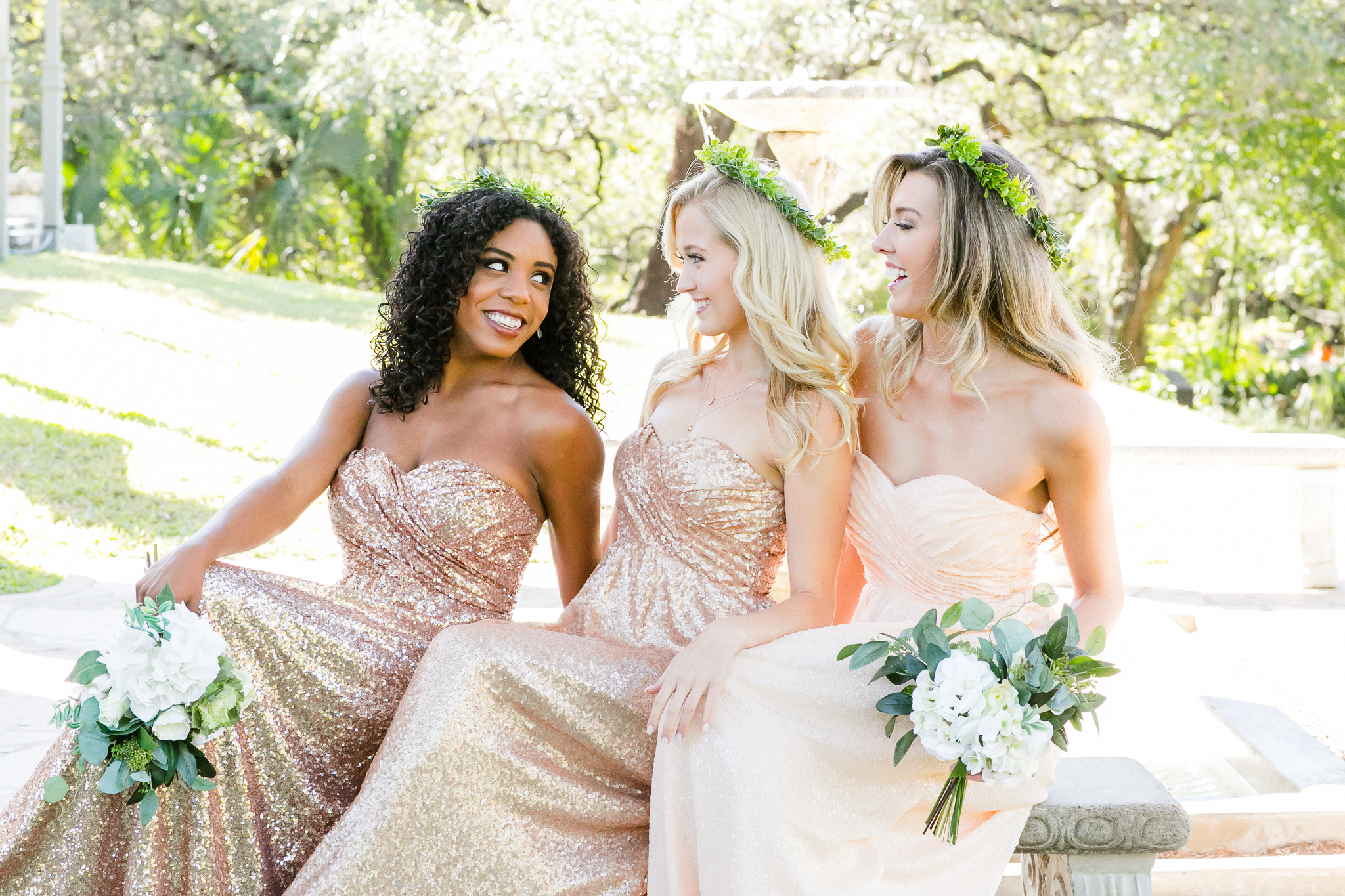 three sleeveless rouched celeste sequin gowns each in a different color. Rose gold, matte rose gold, and barely blush sequin dresses match perfectly with outdoor ceremony setting.