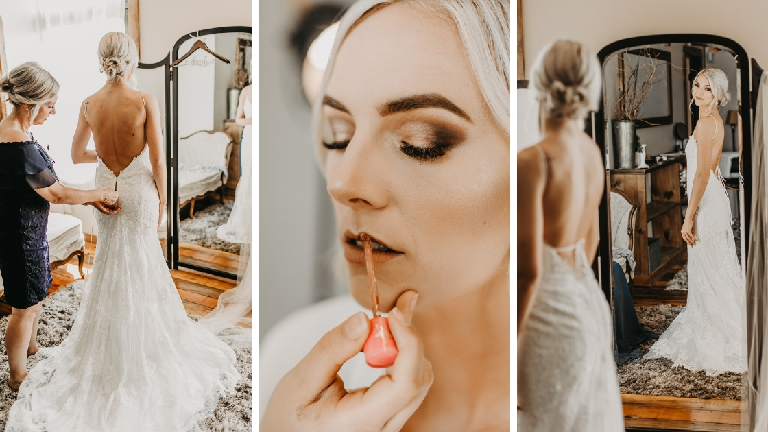 Beautiful blonde bride in fitted wedding dress gets ready on her wedding day close up uf gorgeous smokey eye
