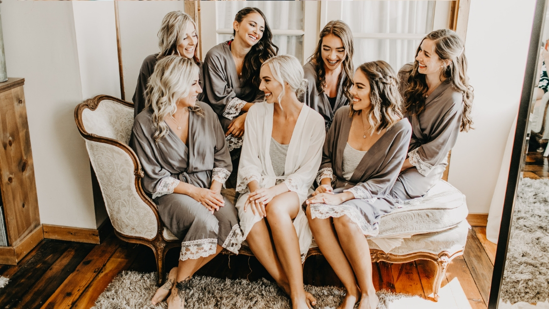 Beautiful bridesmaids in grey lace robes and smile laugh on their best friend's wedding day