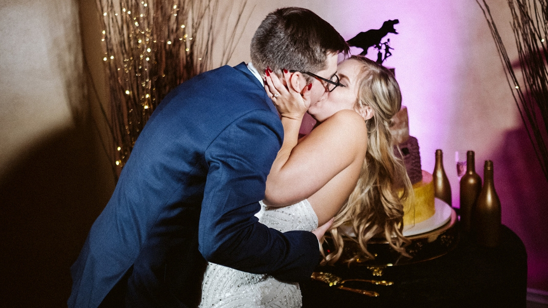 Blonde bride and groom kissing cutting cake love couple relationship wedding day marriage love