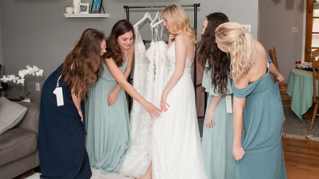 Bridal gown bride in wedding dress pose at try-on party revelry bridesmaid dresses blue and green chiffon off the shoulder dresses at house