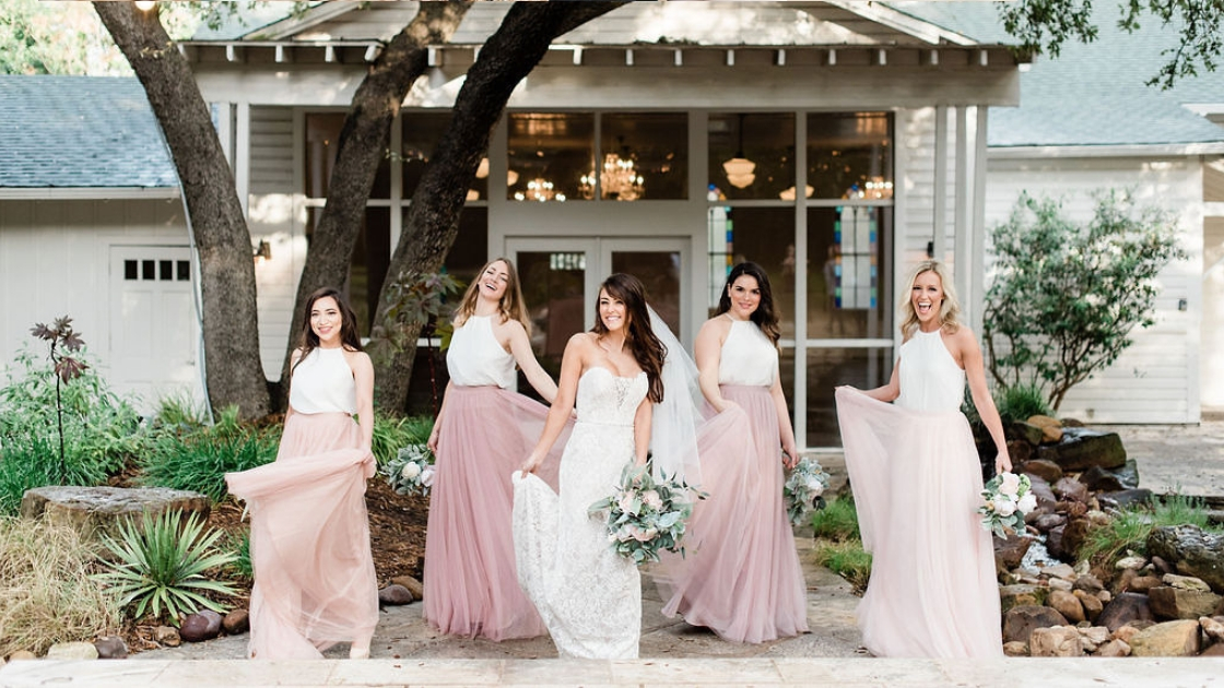 Bride and bridesmaid in skylar tulle skirts pink blush high neck separates revelry gowns bride wedding dress flowers austin texas wedding venue