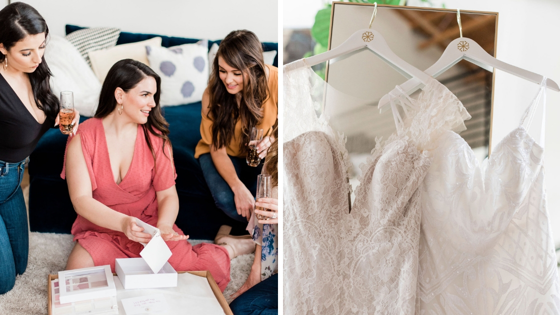Bride and bridesmaids sitting on couch and floor drinking champagne looking at sample box picking illusion color for bridal gown two wedding dresses hanging up revelry bridal gowns on white hangers with gold logos