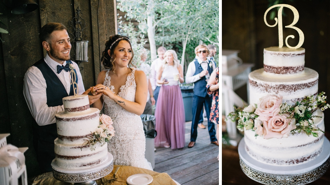 bride and groom cutting cake at wedding holding knife and smiling and being in love