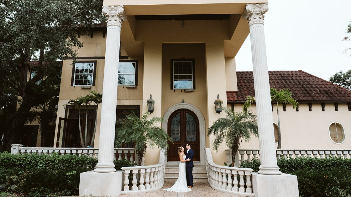 Bride and groom in ybor tampa florida rental mansion beautiful pretty