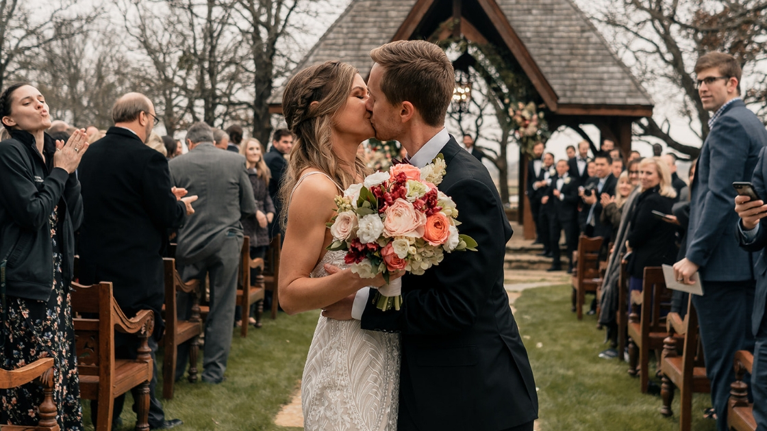 Bride and groom kissing revelry decklyn lace wedding dress kiss after ceremony good love bouquet