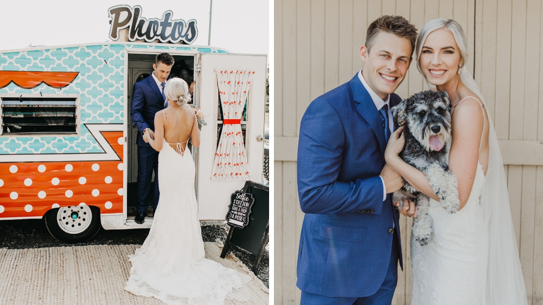 Bride and groom posing in photobooth with family dog