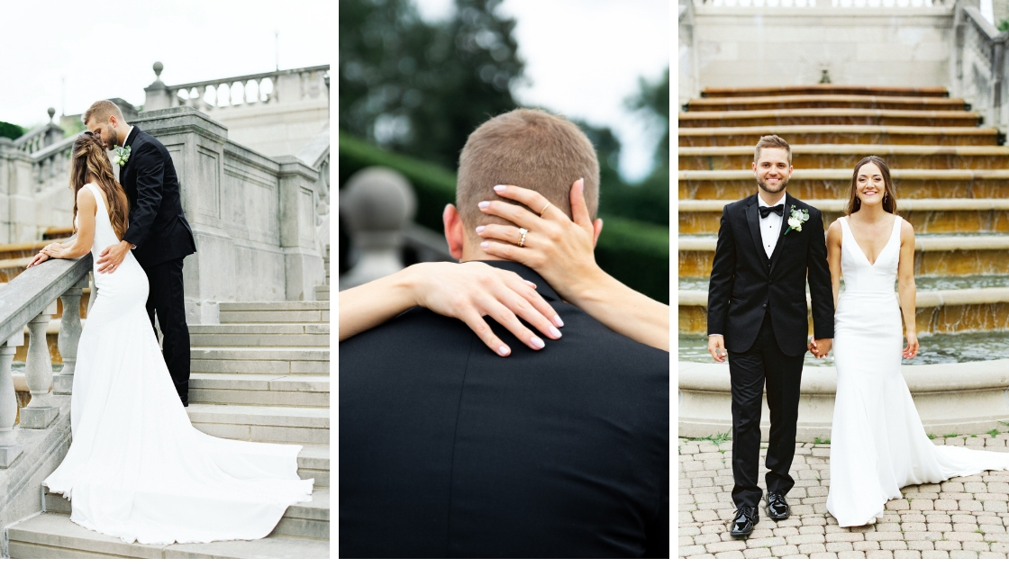 Bride and groom smiling and posing in front of fountain on onn stairs wedding day brunette half up hair shot of bride ring back of head
