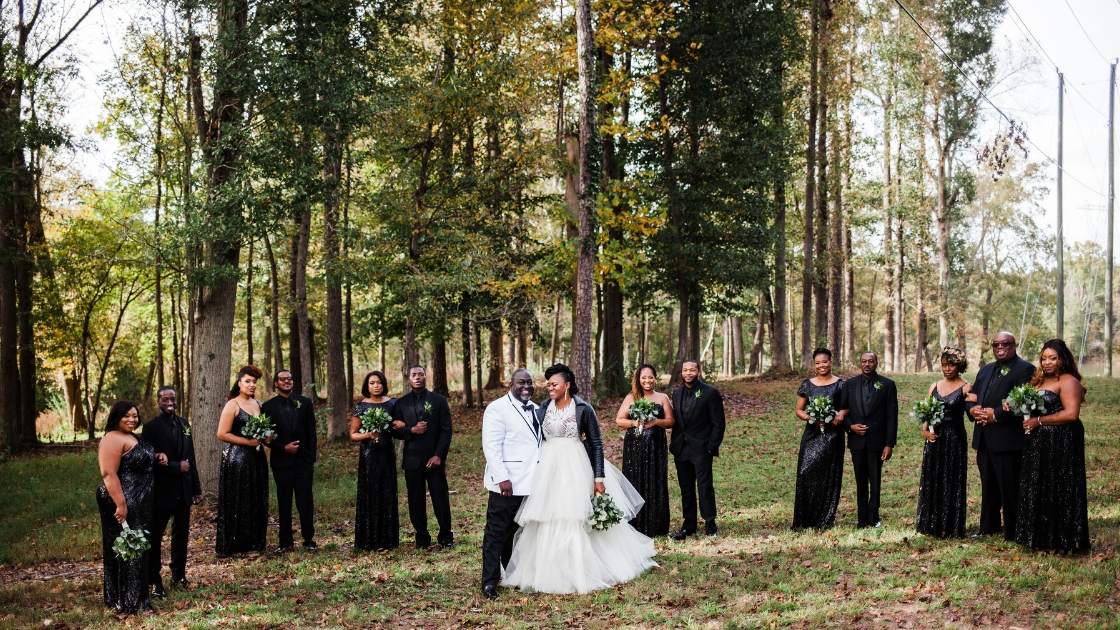 Bride and groom white tulle wedding dress skirt bridesmaids in black tue revelry sequin bridesmaid dresses greenery bouquets