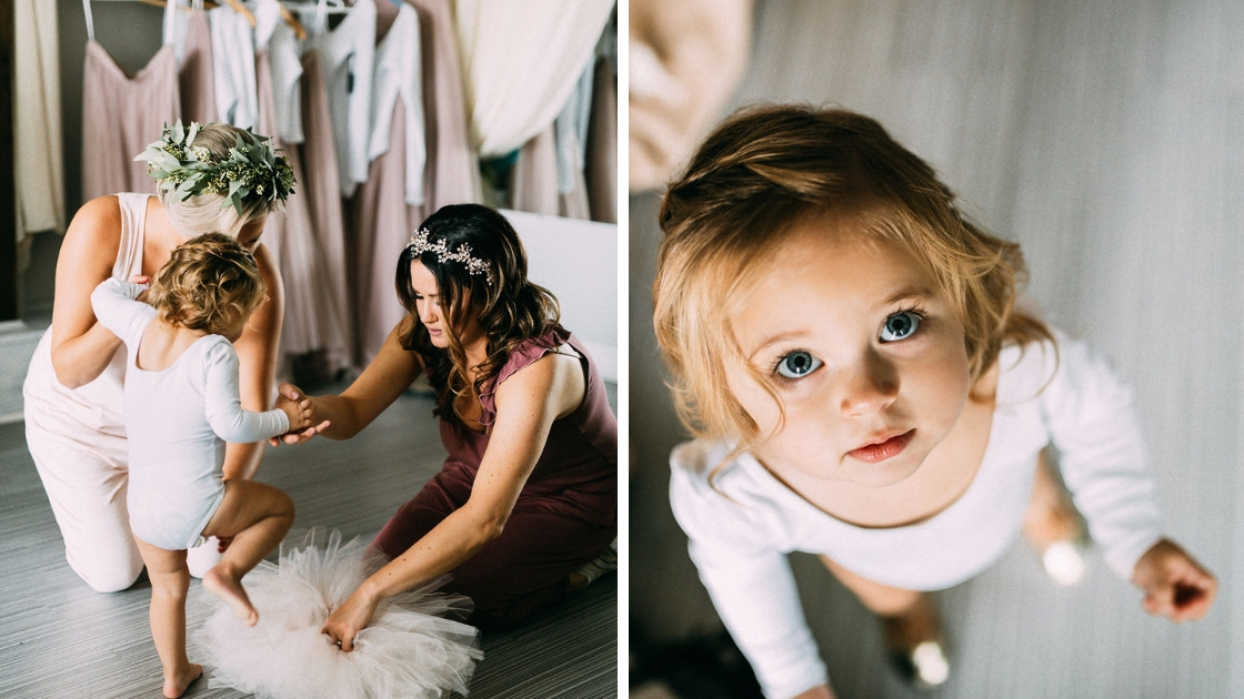 Bride in burgundy romper with floral crown gets flower girl together on wedding day pink tutu and shot of flower girl looking at camera