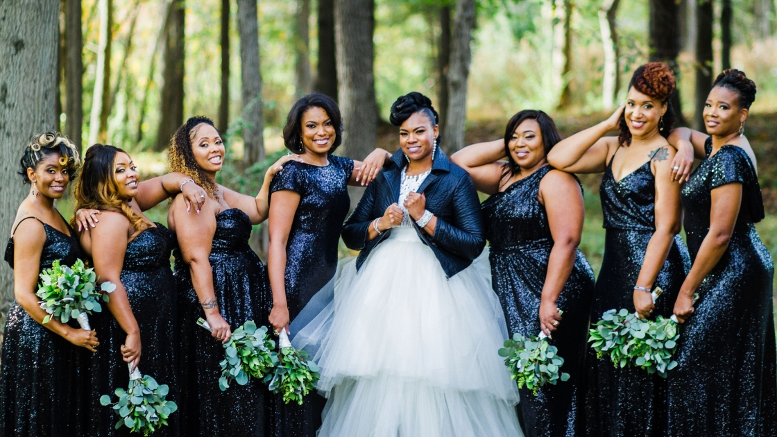 Bride with bridesmaids in black tie sequin revelry dresses happy day