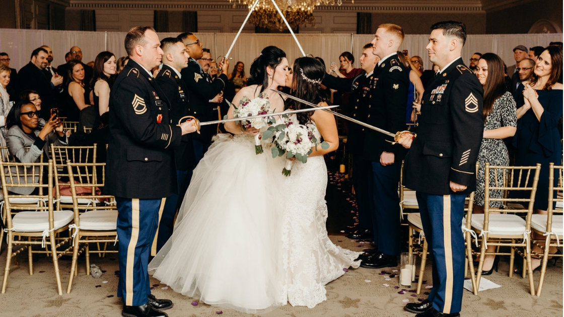 Brides exiting wedding ceremony military swords exit kissing applause wedding