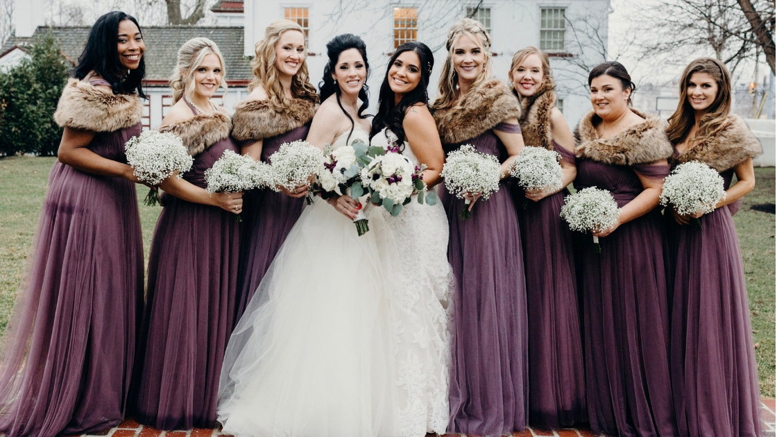Brides in rosalie tulle convertible gowns lavender and wisteria and baby's breath bouquets two brides wedding