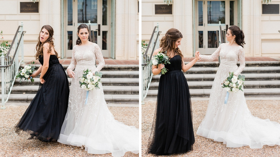 Bridesmaid in black tulle black tie dress bride in wedding dress lace white and green bouquet greenery dancing and posing before wedding ceremony best friends