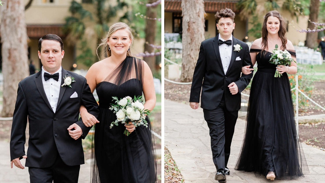 Bridesmaids and groomsmen walking down the aisle black tulle and chiffon dresses holding white and green bouquets rosalie convertible gown one shouldler and off the shoulder dresses