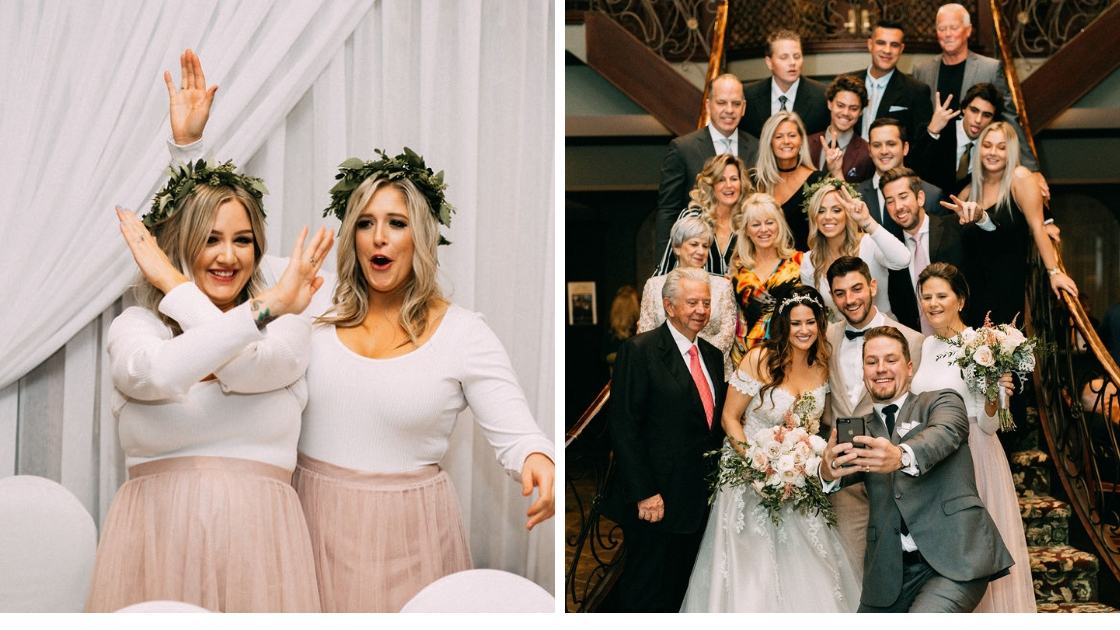 Bridesmaids being silly at head table at wedding with greenery crowns tattoo on wrist family smiling and posing on wedding day taking a selfie with family members on stairs