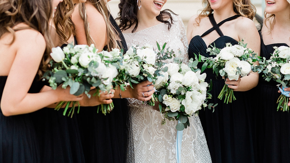 Bridesmaids in black tie dress tulle and kennedy revelry bridesmaid dresses convertible gowns white and greenery florals art deco lace details
