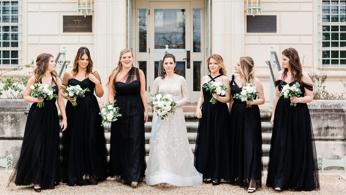 Bridesmaids in black tulle rosalie dresses kennedy chiffon dress black gowns bridesmaids holding white and greenery bouquets