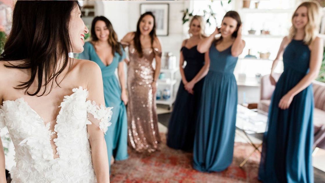 Bridesmaids in blue and gold revelry dresses chiffon sequin bride in aphrodite wedding bridal gown