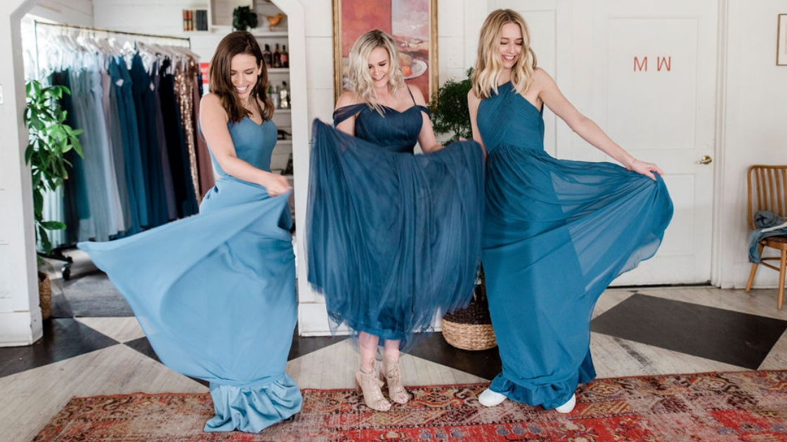 Bridesmaids in chiffon blue dresses tulle dress dancing twirling in dresses at friend's party