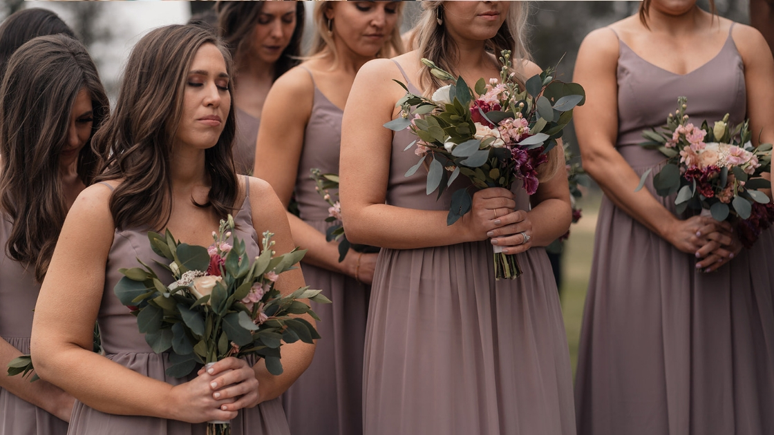 bridesmaids in pink mauve chiffon dress bouquet flowers greenry blush dark pink