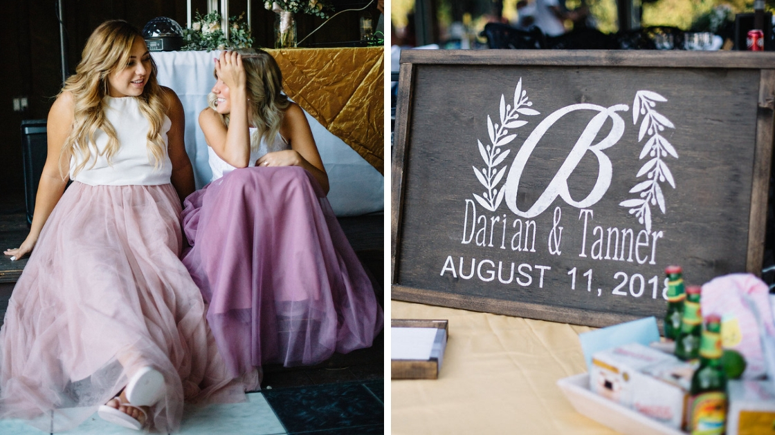 bridesmaids in pink tulle skirts sit and chat at wedding next to couple sign