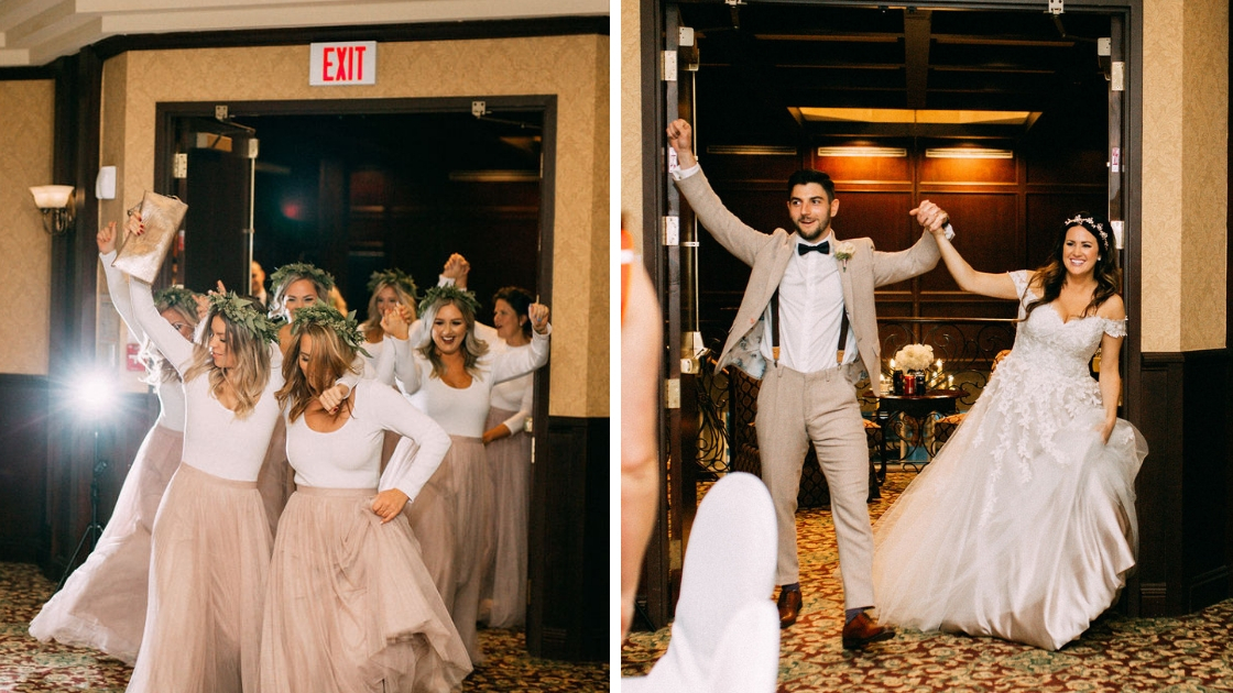 Bridesmaids in revelry tulle pink skirts dance into reception hall and bride and groom enter holding hands in the air smiling and laughing as they enter the party