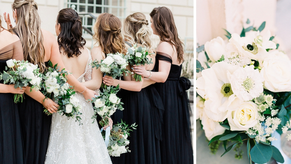 bridesmaids inn black tulle and chiffon dresses face back with bride holding white and green flowers white bouquet hair half up half down