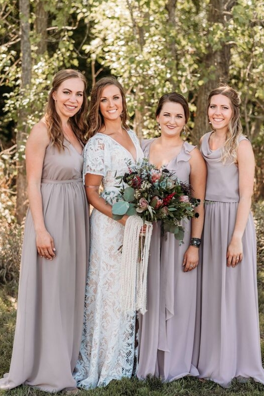 Brunette bride with 3 bridesmaids chuffon dresses mauve and taupe dresses chiffon wrap gowns from revelry