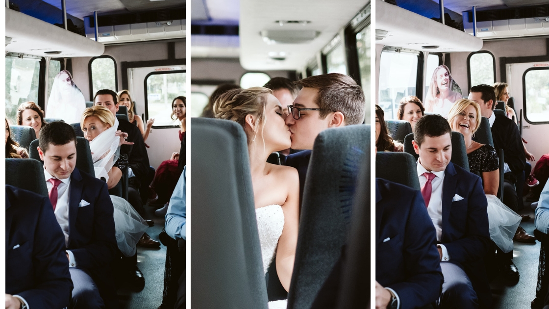 Bus ride on the way to rachel and jons halloween wedding in ybor tampa florida kissing and laughing
