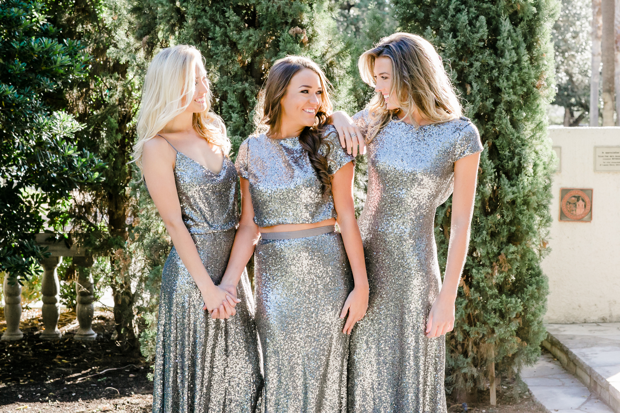 charcoal sequins making bridesmaids look like mermaids. Sequin skirt and top combo looks stunning in this beautiful dynamic color.