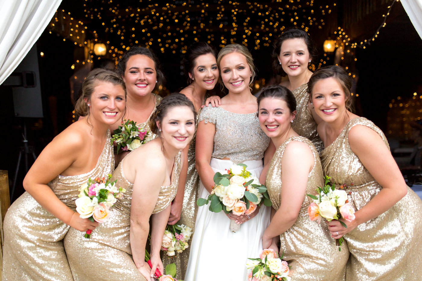 Bride poses with bridesmaids in Ivory Gold Sequin Starla Dresses