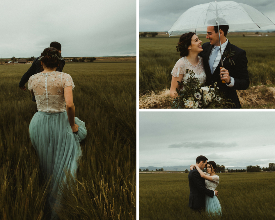 Bride in Revelry tulle skirt walks through the grass with her groom during a stormy wedding day