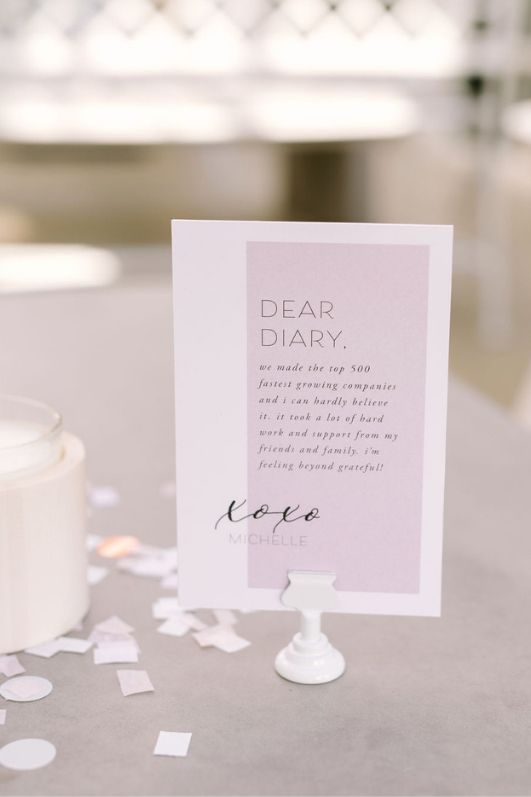 Dear Diary image xox Michelle deloach founder of revelry white and pink card stock on table with confetti
