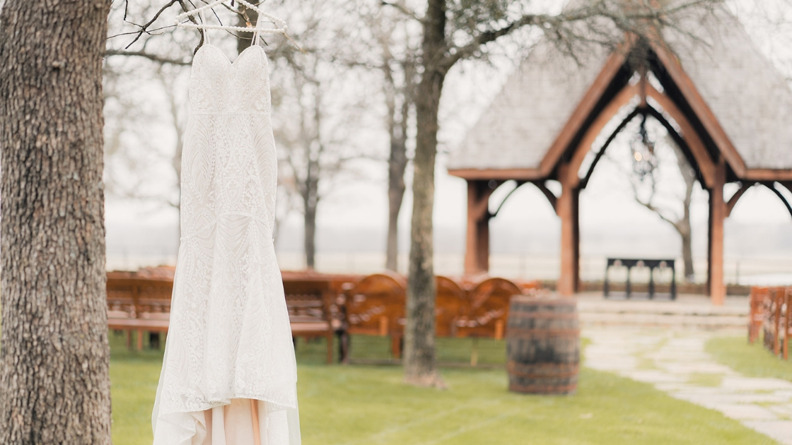 decklyn bridal gown wedding dress hanging at venue in texas winter wedding