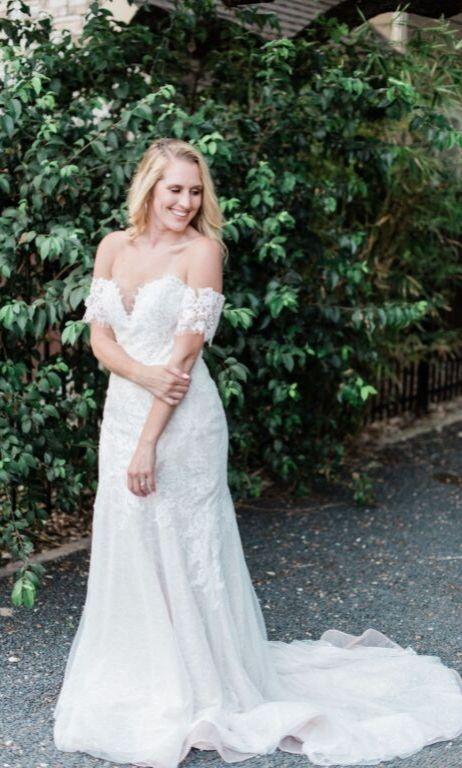 Dee finally the bride in off the shoulder wedding dress blonde bride smiling and posing