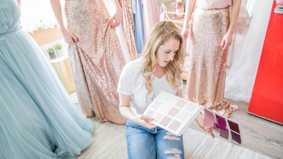 Deidra Dee finally the bride blonde bride sitting on floor looking through color options try on party looking through swatches chiffon tulle and sequin rose gold sequin dresses blue tulle dresses