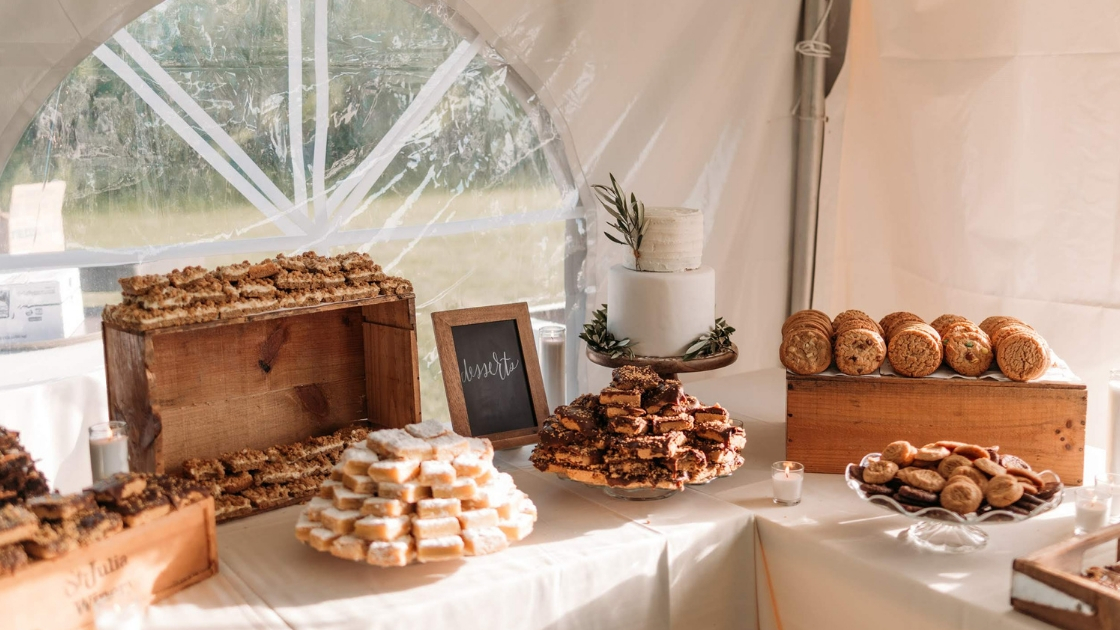 Desserts reception wedding white simple cake cookies dessert bars at country wedding reception in vineyard
