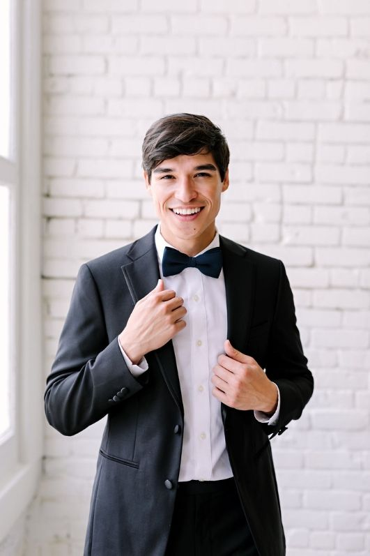 First photo tie and bowtie soft launch blog navy blue revelry bow tie model holding jacket and smiling link