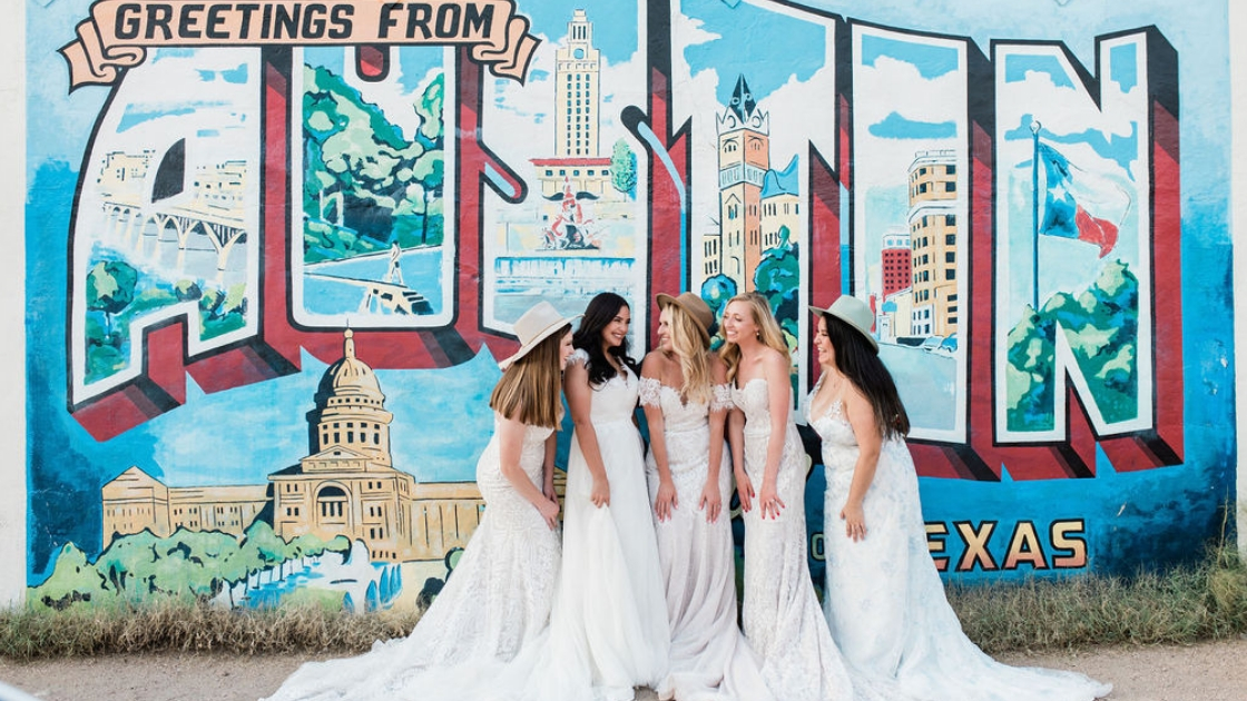 Five finally the bride revelry brides in wedding dresses smile and laugh together in texas for friendship retreat two blonde brides and 3 brunette