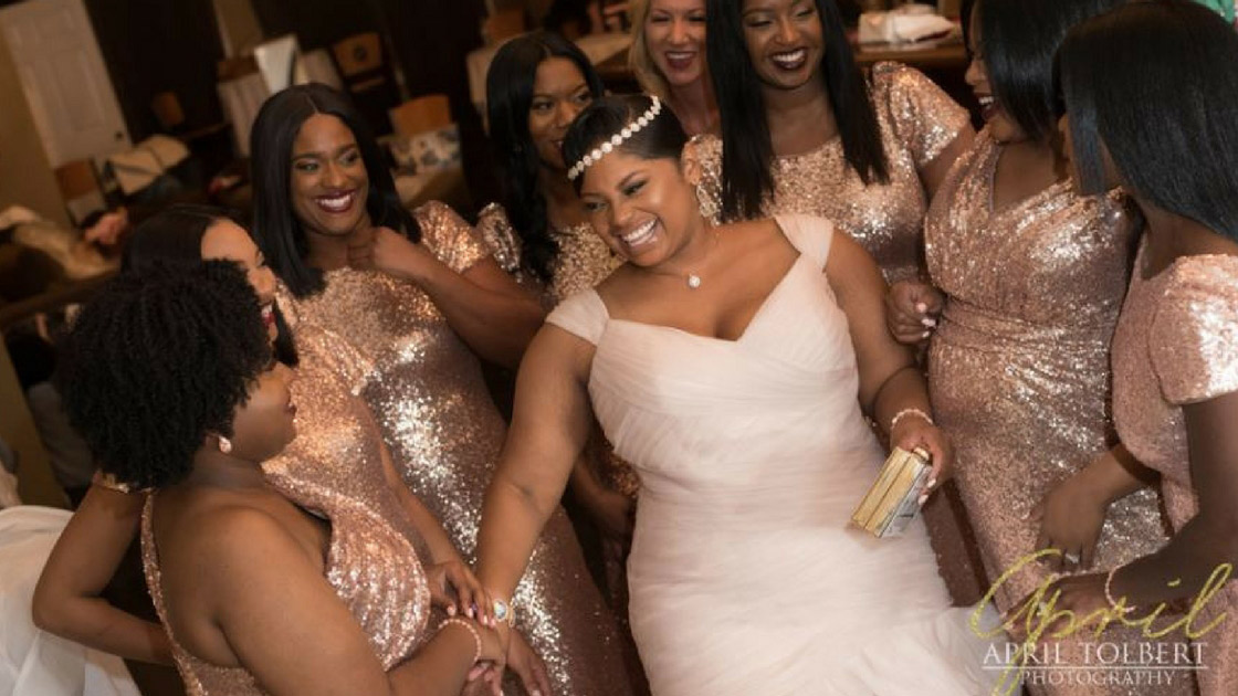 Bride posing with bridesmaids in rose gold Sequin Dresses