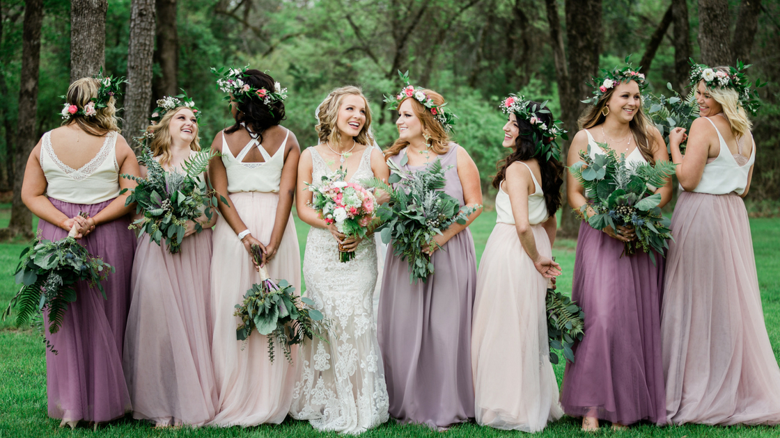 bralettes peaking out from chiffon heidi top to create a bohemian vibe with tulle bridesmaid skirts in purples and blushes.