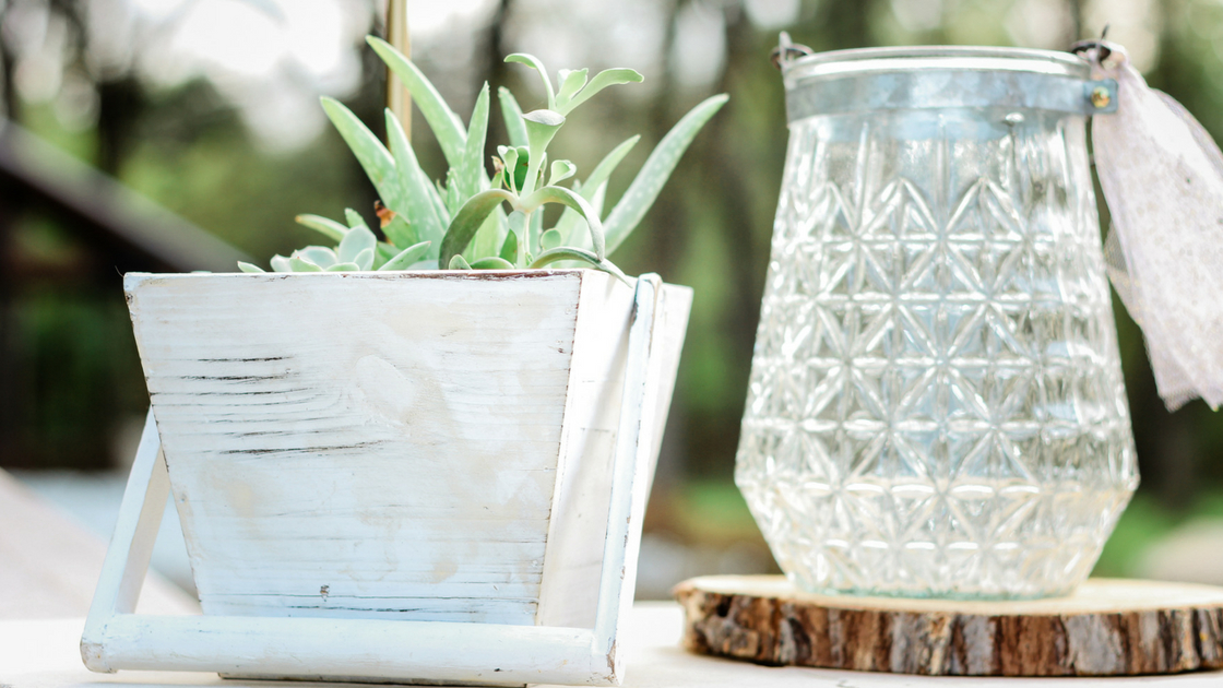 all the details with wood accents, glass jars, and greenery.