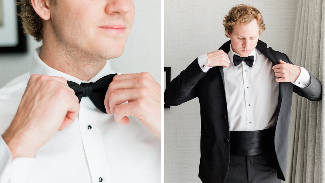 Groom on wedding day tying black bow tie tux shirt putting on tux jacket with cufflinks on wedding day